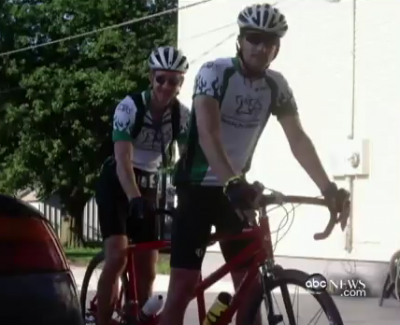 Dr. Jay Alberts and friend on his tandem bicycle